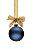 Traditional blue Christmas ball. Hanging on a ribbon isolated on white background Royalty Free Stock Photography