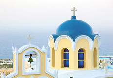 Traditional blue cupola in Santorini Stock Photo