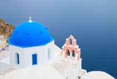 Traditional blue dome with blue sea, Santorini Royalty Free Stock Photos