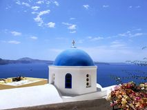 Traditional blue dome church against blue sky, Santorini, Greece. Traditional blue dome church with blue sky, Santorini, Greece, can be used as a wallpaper or stock images