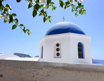 Traditional blue dome church with blue sky, Santorini, Greece. Can be used as a wallpaper or print and hang on your wall royalty free stock photography