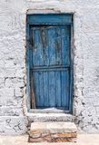 Traditional blue door on a cyclades island Royalty Free Stock Photos