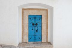 Traditional blue door with ornament, Tunisia, Africa stock photography