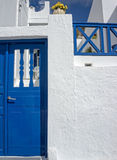 Traditional blue door on a white wall Royalty Free Stock Photo