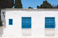 Streets of Sidi Bou Said with traditional white and blue architecture, Tunisia. Traditional blue doors and windows on the white houses on the streets of Sidi Bou royalty free stock images