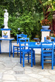 Traditional blue greek chairs in a backyard Stock Images