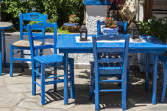 Traditional blue greek chairs in a backyard Stock Image