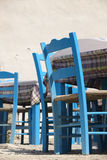 Traditional blue greek chairs in a taverna Stock Photography