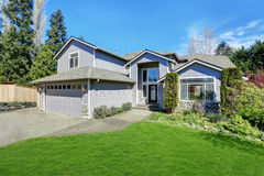 Traditional blue home exterior in Puyallup with wood siding Stock Image