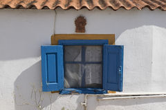 Traditional blue painted greek window Stock Photos
