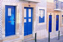 Traditional blue street doors old tiles, Barrio Alto, Lisbon. Old street with blue front doors and old Portuguese tiles at the walls in Barrio Alto dustrict Royalty Free Stock Photos