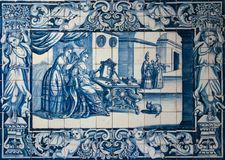 Traditional blue tiles or azulejos decorated with a domestic scene. Lisbon. Portugal. 17 century traditional Lisbon tiles (azulejos) depicting a lady combing her Royalty Free Stock Photo
