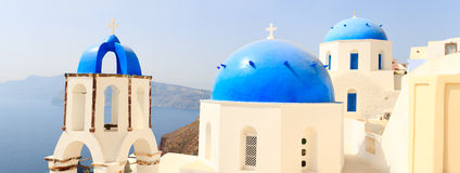 Traditional blue and white church. Panorama of traditional blue and white church closeup in Santorini Greece Royalty Free Stock Photo