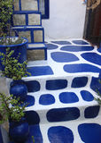 Traditional Blue and White Greek Steps with Flowers Stock Images
