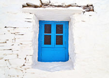 Traditional blue window at Sifnos island Greece stock image