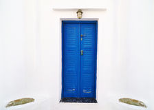 Traditional blue wooden door at Sifnos island Greece royalty free stock image