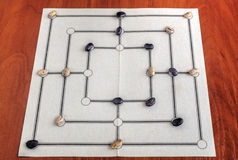Traditional board for playing Nine Men's Morris game Stock Photography