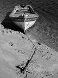 Traditional boat. Traditional portuguese fishing boat anchored at the beach Royalty Free Stock Photos