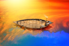 Traditional Boat in Bangladesh. Poor man riding old style boat on the river in bangladesh royalty free stock photo