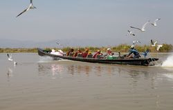 Traditional boat with buddhist monks on the Inle Lake Stock Images