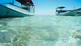 A traditional boat with clear sea white close up take from sea and front of boat stock images