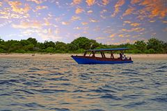 Traditional boat on Gili Meno beach in Indonesia. Asia at sunset Stock Images