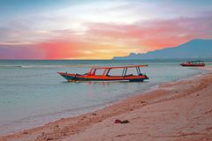 Traditional boat on Gili Meno beach in Indonesia, Asia. At sunset Royalty Free Stock Photos