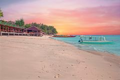 Traditional boat on Gili Meno beach in Indonesia at sunset. Traditional boat on Gili Meno beach in Indonesia, Asia at sunset Stock Photo