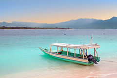 Traditional boat on Gili Meno island beach, Indonesia at sunrise Royalty Free Stock Image