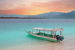 Traditional boat on Gili Meno island beach, Indonesia at sunset Stock Photography