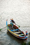 Traditional boat on the lake near U-bein Bridge in Myanmar. Stock Image
