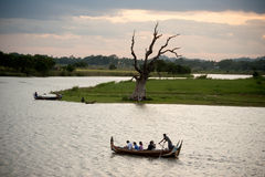 Traditional boat on the lake near U-bein Bridge in Myanmar. Royalty Free Stock Photos