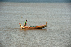 Traditional boat on the lake near U-bein Bridge in Myanmar. Stock Photography