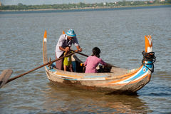 Traditional boat on the lake near U-bein Bridge in Myanmar. Royalty Free Stock Images