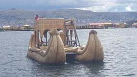 Traditional boat on lake titicaca. A boat made of reeds on the floating islands of lake titicaca Stock Photography