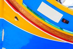 Traditional colorful boat luzzu at the port of Marsaxlokk, Malta. Copy space, closeup view. Traditional boat luzzu detail with bright colors at the port of stock images