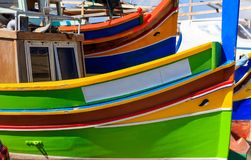Traditional colorful boat luzzu at the port of Marsaxlokk, Malta. Copy space, closeup view. Traditional boat luzzu detail with bright colors at the port of stock photo