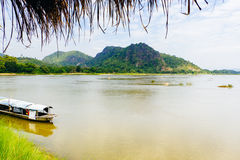 Traditional boat on the Mekong river in Loei province Thailand. Looking toward Laos Stock Photos
