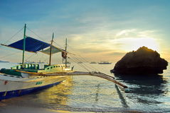 Traditional boat on the ocean at sunset in Phillipines. Authentic boats at sunrise on the blue turquoise sea water in Boracay, tropical beach Royalty Free Stock Photo
