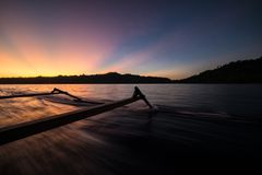 Traditional boat riding at sunset Royalty Free Stock Photo