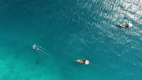 Traditional boat sails on tranquil waves, aerial, topview. Rustic wooden traditional fishing boat sails on the tranquil waves of the ocean, aerial, topview stock video footage