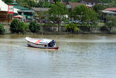 Traditional boat on Sarawak river in Kuching city Stock Photo