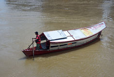 Traditional boat on Sarawak river in Kuching city Royalty Free Stock Photography