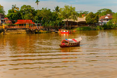 Traditional boat on Sarawak river from waterfront in Kuching city. Sarawak. Borneo. Malaysia Royalty Free Stock Images