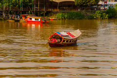 Traditional boat on Sarawak river from waterfront in Kuching city. Sarawak. Borneo. Malaysia Stock Photography