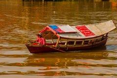 Traditional boat on Sarawak river from waterfront in Kuching city. Sarawak. Borneo. Malaysia Stock Photo