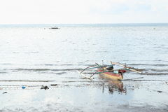 Traditional boat on the sea. Traditional indonesian wooden boat on the sea Royalty Free Stock Photo