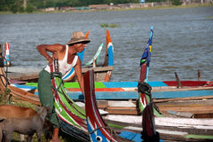 Traditional boat on the shore of the lake near U-bein Bridge. Stock Images