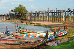 Traditional boat on the shore of the lake near U-bein Bridge. Royalty Free Stock Photography