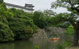 Traditional Boat with sightseeing Tourists and Guide in the Inner Moat of Himeji Castle. Himeji, Hyogo, Japan, Asia royalty free stock image